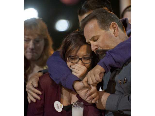 The family of Nicole Hoffman mourn at a candlelight vigil at Central Park on Tuesday. Hoffman and her boyfriend Robert Corona Jr. died during the weekend from injuries they sustained in a car crash Friday night. Photo by Charlie Kaijo.