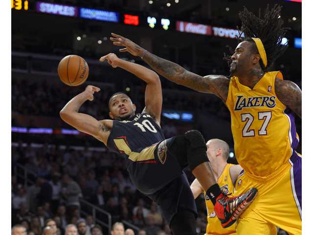 New Orleans Pelicans guard Eric Gordon, left, passes the ball as Los Angeles Lakers center Jordan Hill defends on Tuesday in Los Angeles.
