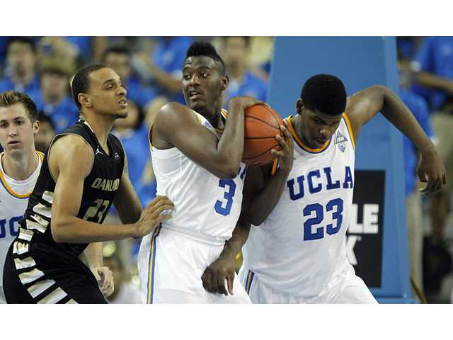 UCLA guard Jordan Adams (3) pulls down a rebound against Oakland on Tuesday in Los Angeles. UCLA won 91-60.