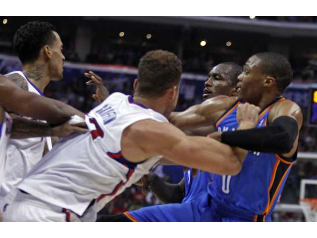 Clippers Matt Barnes and Blake Griffin tangle with Oklahoma City's Serge Ibaka (left) and Russell Westbrook