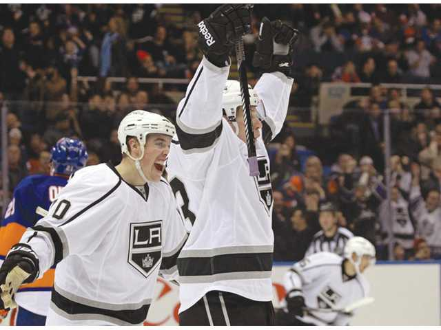 Los Angeles Kings center Tyler Toffoli, right, and Kings left wing Tanner Pearson (70) celebrate after Toffoli scored the go-ahead goal in Uniondale, N.Y. on Thursday.