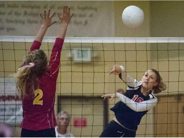 Santa Clarita Christian outside hitter Kylie Brown, right, hits the ball against Coastal Union on Thursday night at SCCS.