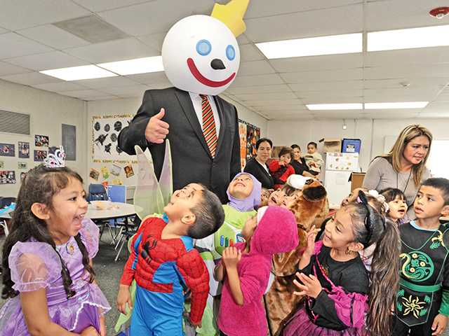"Damion Rodriguez, dressed as ""Jack"" from Jack-in-the-Box for halloween, brought tacos as he visited the 24 students at the preschool class at Newhall District State Preschool in Newhall for their fall festival."