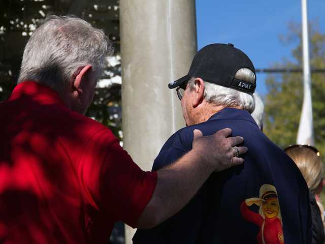 "Titled ""Touched,"" Sanders said she was just lucky enough to ""capture two brothers in arms"" at the Veterans Day Ceremony on Nov. 11, in Newhall. The ceremony was held at Veterans Historical Plaza."