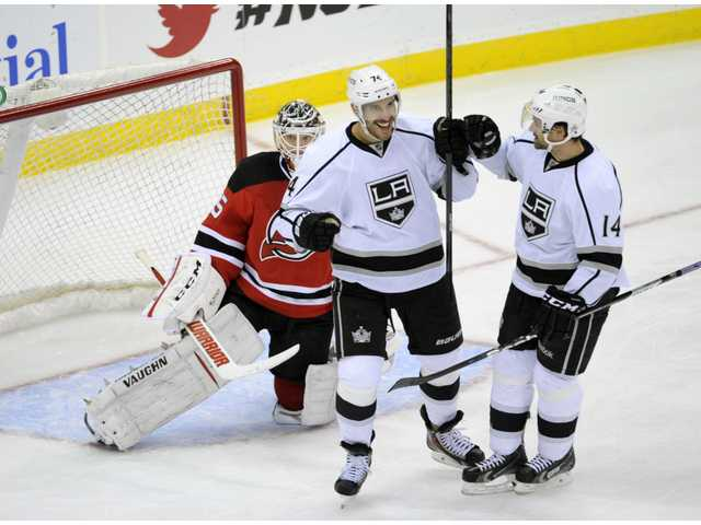 Los Angeles Kings' Dwight King celebrates his goal with Justin Williams, right. Los Angeles scored both of its goals in the third period.