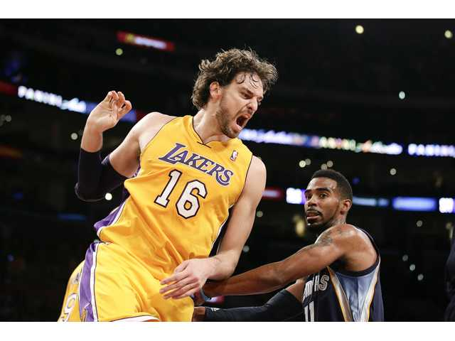 Pau Gasol celebrates after scoring a basket. Gasol struggled on Friday, going 4-12 from the field in the Lakers' loss.
