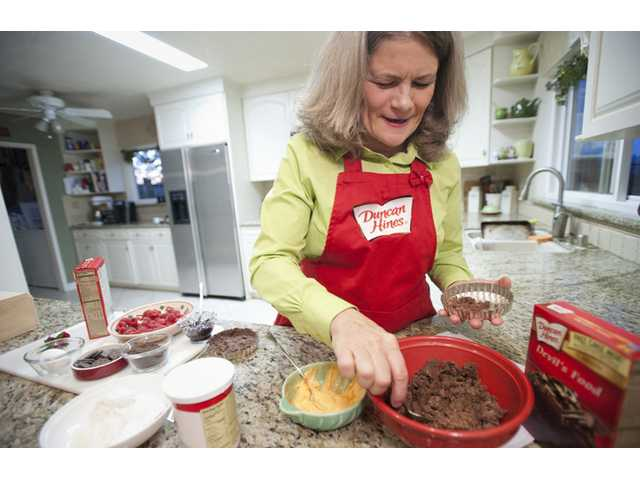 Merry Graham, winner of the Duncan Hines Sweet Stars, prepares the crust for her award winning chocolate crusted tart recipe on Wednesday. Photos by Charlie Kaijo