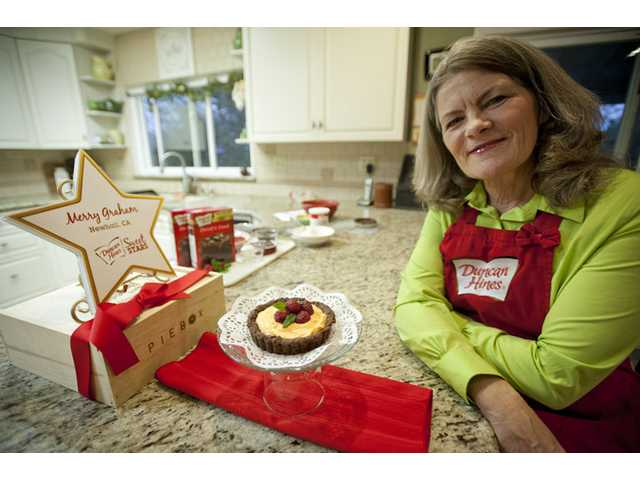 Merry Graham poses for a picture with her Duncan Hines Sweet Stars award winning chocolate crusted tart at her home in Newhall on Wednesday. Photo by Charlie Kaijo