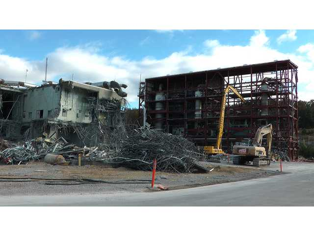 In this photo taken Tuesday, workers continue the process of demolishing chemical waste incinerator at the Anniston Army Depot in Anniston, Ala. The Pentagon spent $10.2 billion over three decades burning chemical weapons stored in four states.