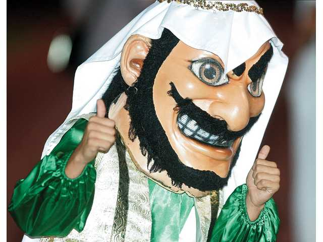 "In this Sept. 10, 2010 photo, Coachella Valley High School's mascot, ""Arab,"" gives the thumbs during a game against Yucca Valley, in Thermal."