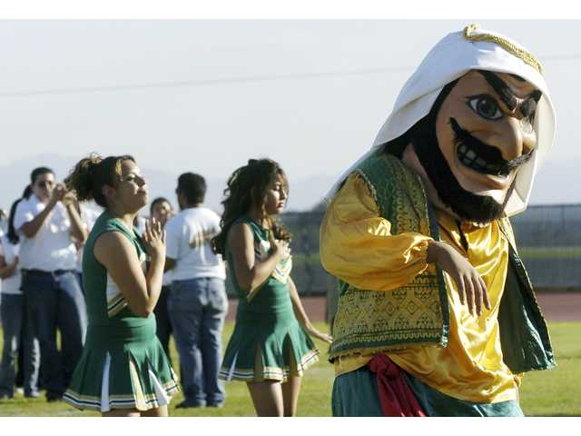 "In this Nov. 10, 2005 file photo, Coachella Valley High School's mascot, ""Arab,"" dances to the band during a pep rally at the school in Thermal, Calif."