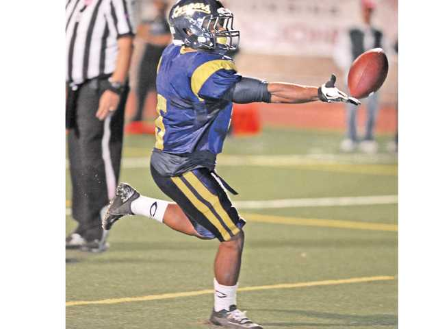 COC running back Matt Bowen (5) tosses the ball to the ref afterscoring a touchdown against Cerritos on Nov. 9.