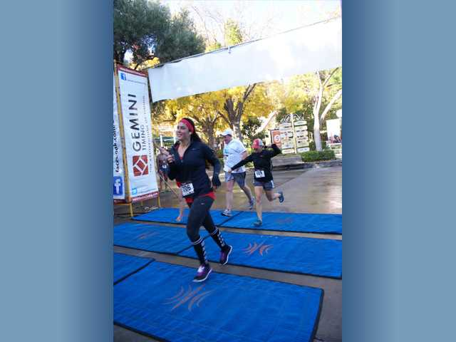 Runners reach the finish line at the HandsOn Santa Clarita race at Six Flags Magic Mountain on Sunday. Photo by Jim Holt.