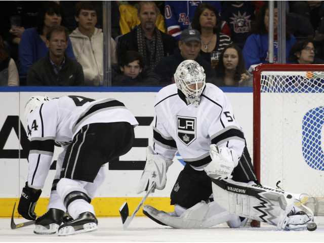 The puck glances off the skate of Los Angeles Kings goalie Ben Scrivens (54), who shutout the Rangers on Sunday.
