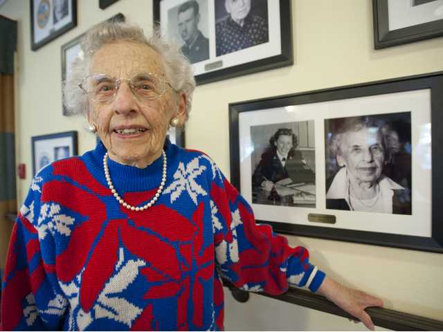 Harriet Zielke poses for a photograph next to her portrait on the Wall of Honor at the Summerhill Villa retirement community. She served in the Navy during the 1940s. Signal photo by Charlie Kaijo