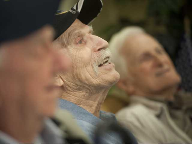 Russell Garland recalls stories about being a photographer during his time in the Navy at the Summerhill Villas retirement community. Signal photo by Charlie Kaijo