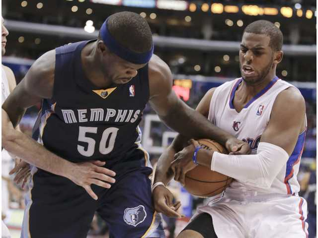 Zach Randolph (left) and Chris Paul (right) fight for a loose ball on Monday night at the Staples Center. The Grizzlies won 106-102.