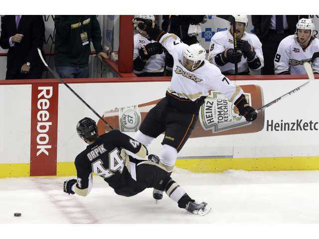 Anaheim Ducks' Devante Smith-Pelly (77) collides with Pittsburgh Penguins' Brooks Orpik (44) in the first period.