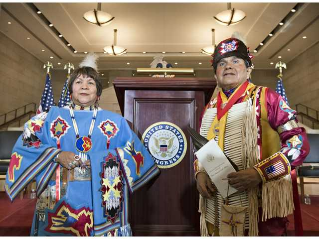 John Parker, right, and his sister LaNora Parker, left, members of Comanche Nation in Oklahoma, arrive for a Congressional Gold Medal ceremony on Capitol Hill in Washington Wednesday, honoring Native American code talkers who used their unique languages as a means of secret communication that enemy troops could not decipher during World War II.