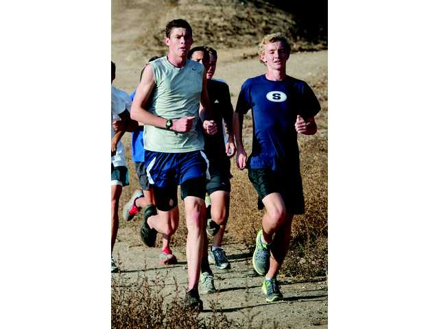 On Saturday, the Saugus cross country team will race at the CIF-Southern Section championships. That team is led by Alex Pearson, left, and Brian Zabilski.