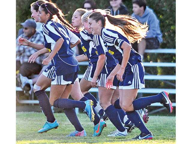 Stacey Atwater, right, and her College of the Canyons teammates celebrate after during a game against Bakersfield College at COC on Oct. 8.