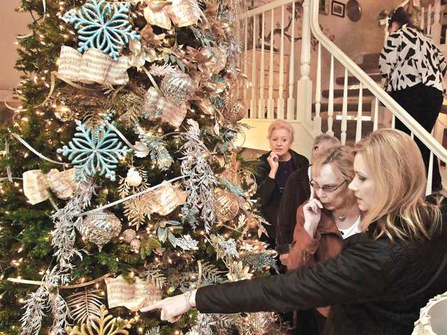 Tour participants look at a Christmas tree at the Daily residence in Santa Clarita on Wednesday for the Holiday Home Tour.