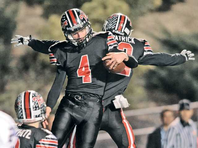 Hart's Trent Irwin (4) celebrates with Wes Fitzpatrick (22) after scoring for Hart in the third quarter against Palos Verdes at College of the Canyons on Friday.