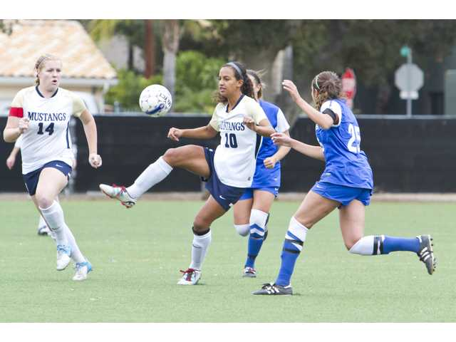 TMC midfielder Jordan Benson (10) tries to control the ball as CSUSM defender Nicole Luna (25) gives chase and Mustangs teammate Natasha Coyle (14) trails. TMC lost 1-0 after falling behind late in the first half to the Cougars.