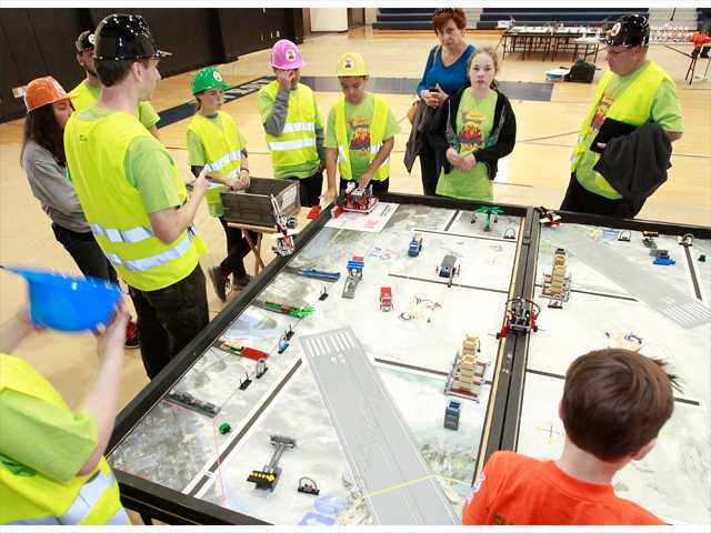 Leona Cox Elementary School's Brick Busters team works on final routine plans prior to their competition during the First Lego League Challenge held at West Ranch High School on Sunday. The mission was to build and program robots to respond to natural disasters. Photo by John Lazar for The Signal.