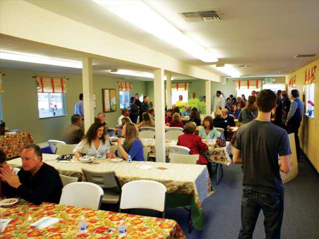 Scores of people enjoy hot soup served up by volunteers during the first Soup for the Soul fundraiser by Bridge to Home in Saugus on Sunday. Photo by Jim Holt.