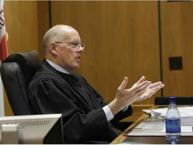 Sacramento County Superior Court Judge Michael Kenny questions attorney Stuart Flashman, representing opponents of California's proposed high-speed project, about their lawsuit seeking to halt funding for the bullet train, in Sacramento County Superior Court on Nov. 8.