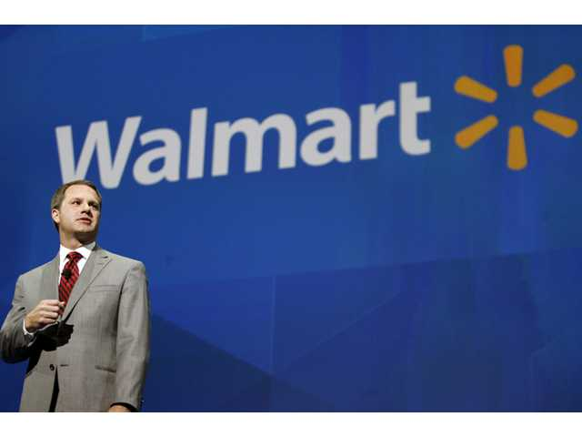 In this June 7 file photo, Doug McMillon, president and CEO of Wal-Mart International, speaks at the shareholders meeting in Fayetteville, Ark.