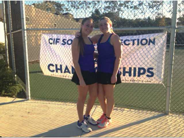 Valencia's Tina Inchalik, left, and Remy Balmain pose on Monday at the CIF-Southern Section girls tennis individual tournament.