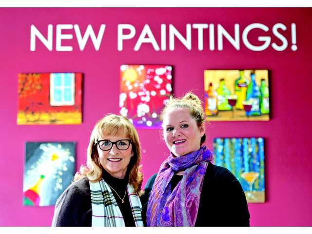 The mother-daughter team of Kathy Guccione, left, and Stephanie Sewell co-own Pinot's Palette in Valencia. The small business offers a sip and paint experience by teaching art and selling wine and picture frames to its customers.
