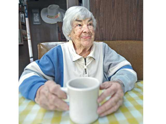 Melba Fisher, 97, enjoys a cup of coffee at the Way Station Coffee Shop in Newhall on Friday. Signal photo by Dan Watson.