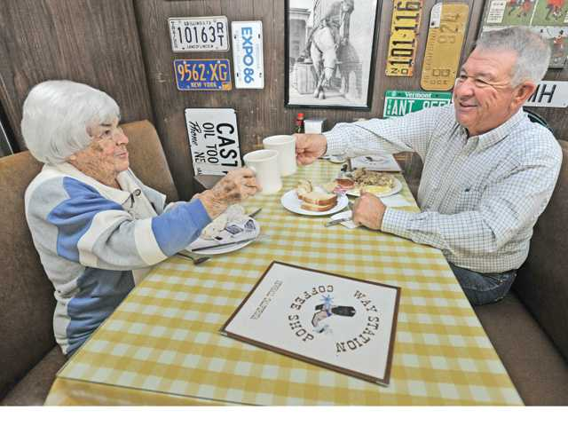 Melba Fisher, 97, and her son Walt sit down to breakfast at the Way Station Coffee Shop in Newhall on Friday. Signal photo by Dan Watson.