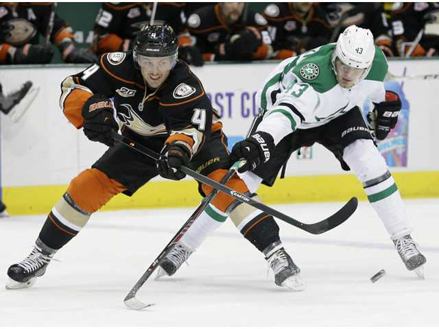Anaheim Ducks defenseman Cam Fowler (4) passes the puck as Dallas Stars right wing Valeri Nichushkin (43) trails in Dallas on Tuesday.