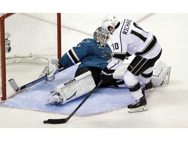 San Jose Sharks goalie Antti Niemi, left, stops a shot from Los Angeles Kings' Mike Richards (10) during Wednesday night's shootout in San Jose.