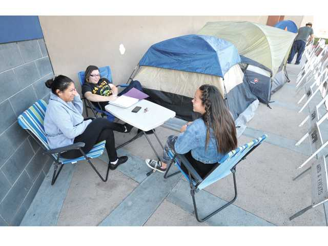 Pre-Black Friday bargain shoppers, from left, Gilma Barnes, Jessica Valdez and Arianna Dowel of Canyon Country who among those camping out in front the Best Buy store in Valencia, expecting to save hundreds of dollars. Photo by Signal Staff Photographer Dan Watson.