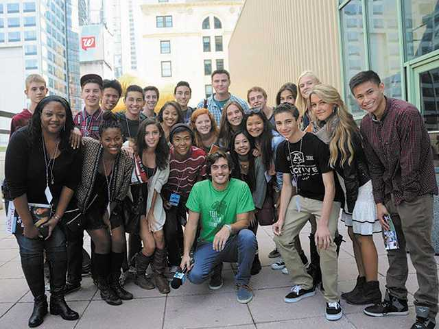 Valencia High School students from Valencia Television celebrate with film festival creator, Andres Janks (green shirt), on the terrace of the AMC Theater in New York city's Times Square.