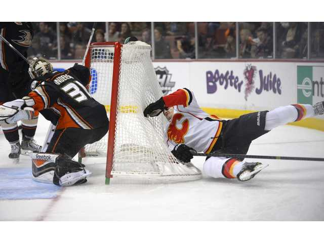 Calgary Flames left wing Lance Bouma, right, loses control as Anaheim Ducks goalie Frederik Andersen, defends on Friday in Anaheim. The Ducks won 5-2.