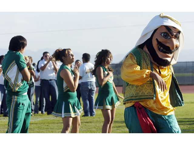 "In this Nov. 10, 2005 photo, Coachella Valley High School's mascot, ""Arab,"" dances to the band during a pep rally at the school in Thermal."