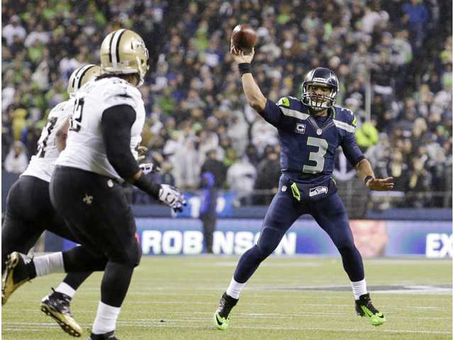 Seattle Seahawks quarterback Russell Wilson (3) throws against the New Orleans Saints on Monday night's game in Seattle.