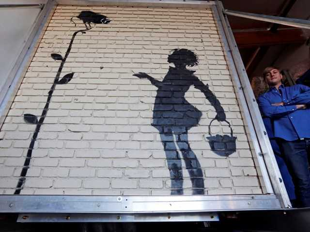"""Flower Girl,"" painted on the brick wall of Los Angeles gas station in 2008 by a celebrated artist. The building's owner carefully removed the 9'x8' section weighing 5,000 lbs."