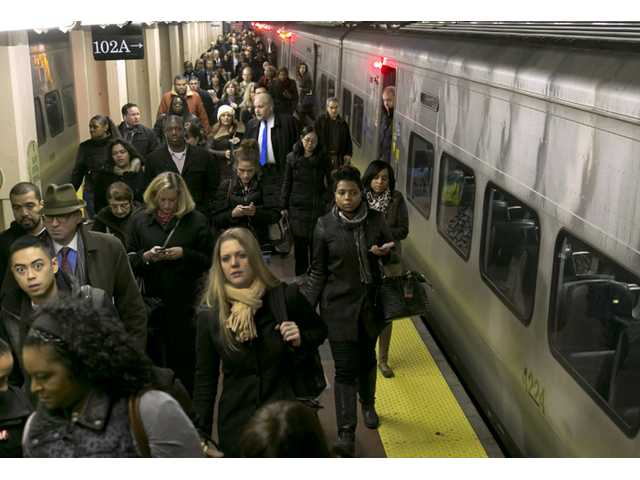 Passengers exit a Hudson Line Metro-North train at New York's Grand Central Terminal as service resumed on Wednesday.
