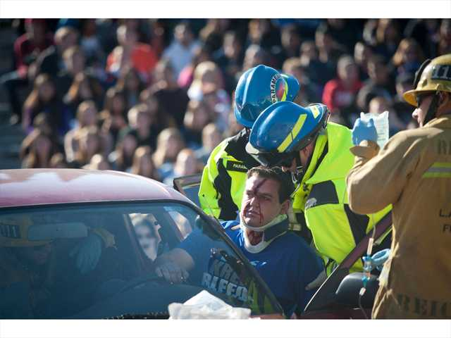 "Paramedics cart out a Saugus High School student role-playing as a drunk driver in the ""Every 15 Minutes"" event on Thursday. Photo by Charlie Kaijo."