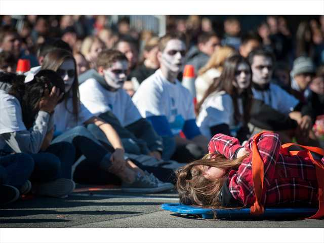 Saugus High School students become emotional after watching paramedics cart out the mock dead bodies of their classmates on Thursday.  Photo by Charlie Kaijo.