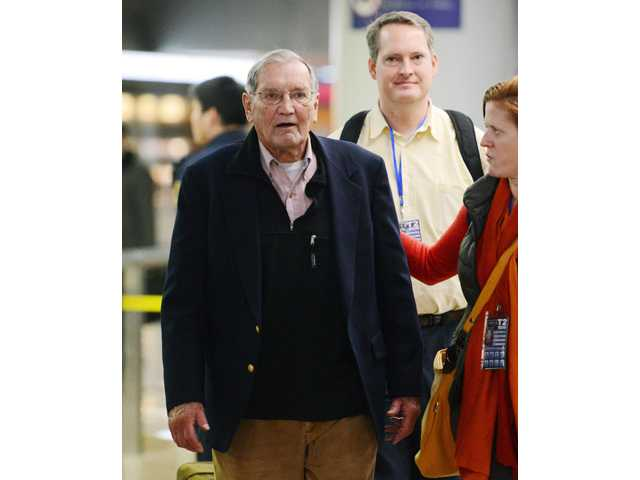U.S. tourist Merrill Newman arrives at Beijing airport Saturday, Dec. 7, 2013 after being released by North Korea.