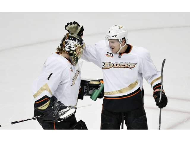Anaheim Ducks goalie Jonas Hiller, left, and defenseman Ben Lovejoy (6) celebrate a win on Friday in Chicago.