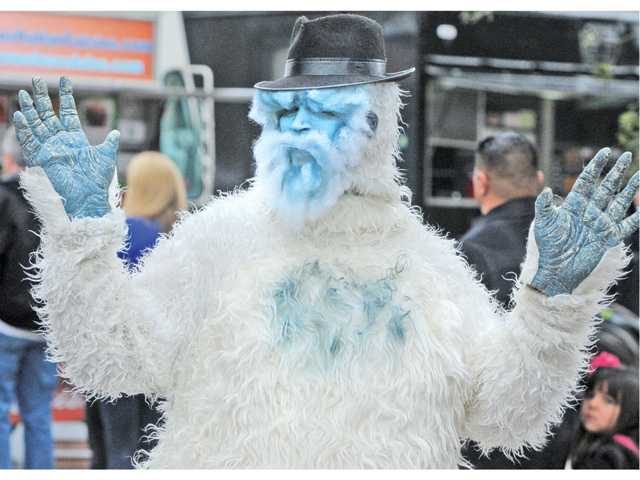 "Local author Stephen Tako dances as Jenga the Yeti, the lead character in the book ""Junga takes a Trip"" on Saturday at the Santa Clarita Literacy and Arts Festival in Newhall."